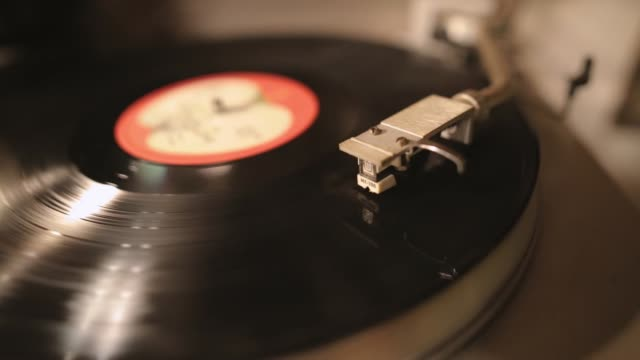 vintage turntable rotating vinyl record, a stylus with a needle - record player stock videos & royalty-free footage