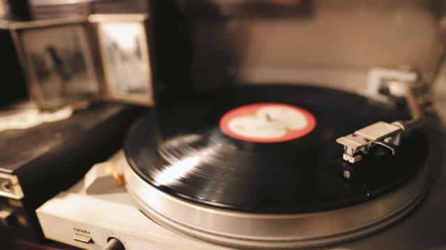 vintage turntable rotating vinyl record, a stylus with a needle - antiquities stock videos & royalty-free footage