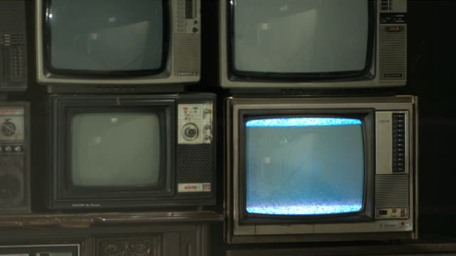 vintage tv set wall with tv flickering. - film set stock videos & royalty-free footage