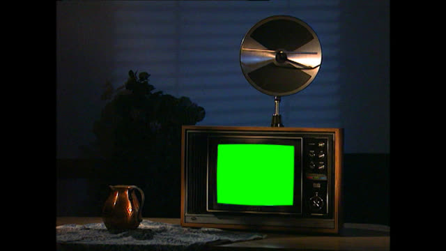 ms of vintage tv set with gold disc aerial and green screen - jug stock videos & royalty-free footage