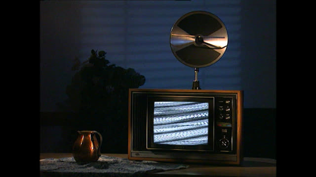 ms of vintage tv set with gold disc aerial and static - television static stock videos & royalty-free footage