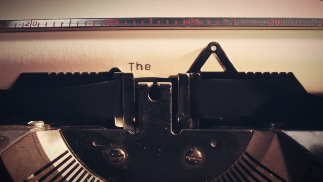 Vintage typewriter with the word 'the end' being typed.