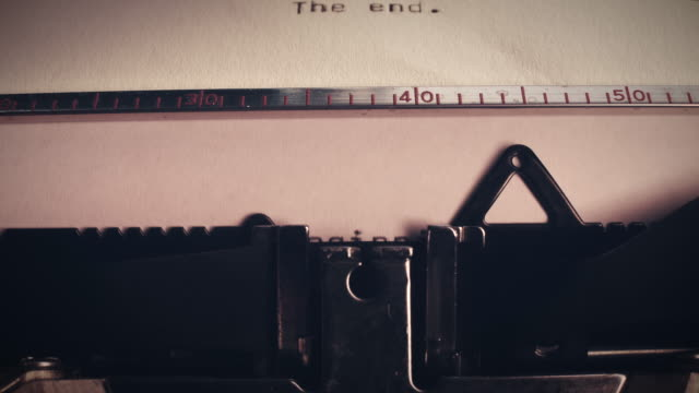 Vintage typewriter with the words 'the end' and 'the beginning'.