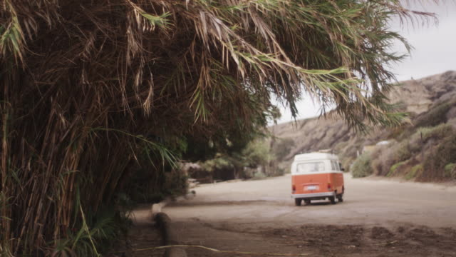 vintage van leaves beach, slow motion - van vehicle stock videos and b-roll footage
