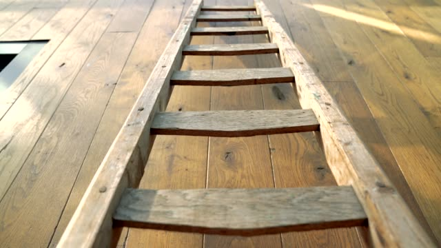 vintage wooden ladder against wall - ladder stock videos & royalty-free footage