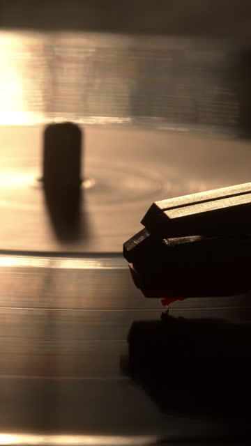 vinyl lp record on a turntable. vertical 4k. - toned image stock videos & royalty-free footage