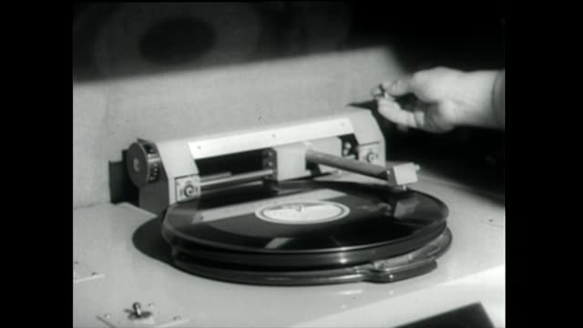 vinyl record being played on a large record player; 1958 - 1955 stock videos & royalty-free footage