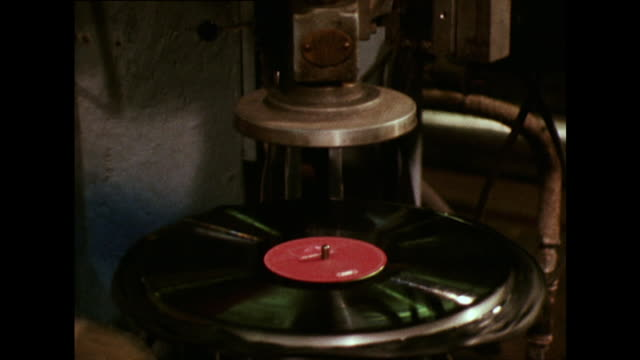 vinyl record is trimmed in factory; 1973 - making stock videos & royalty-free footage