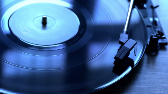 vinyl record on a turntable. high angle. - wide angle stock videos & royalty-free footage