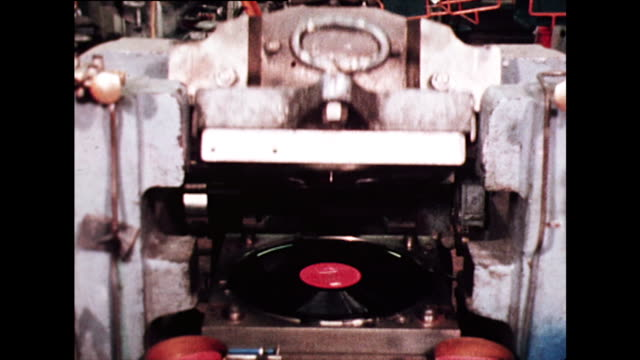 vinyl record press opens to show new record; 1972 - making stock videos & royalty-free footage