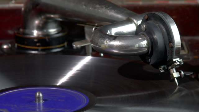 vinyl record spinning on antique victrola record player - audio electronics stock videos and b-roll footage