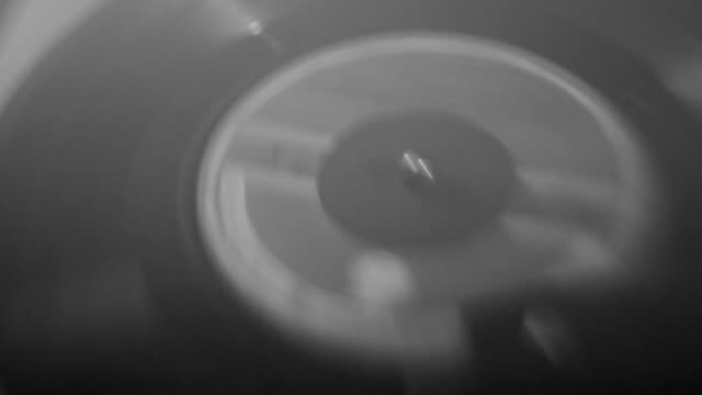 vinyl record spinning on old turntable - turntable stock videos & royalty-free footage