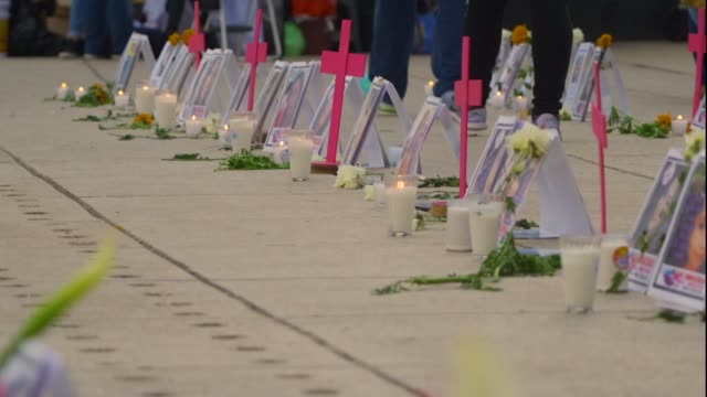 violence against women soars as ten are murdered every day; mexico: mexico city: ext various of temporary memorial to murdered women featuring pink... - murder victim stock videos & royalty-free footage