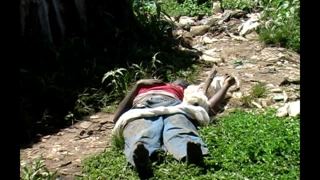 Violence continues after elections KENYA nairobi EXT Body of man from the Kikuyu tribe the same as that of President Mwai Kibaki laying on the ground...
