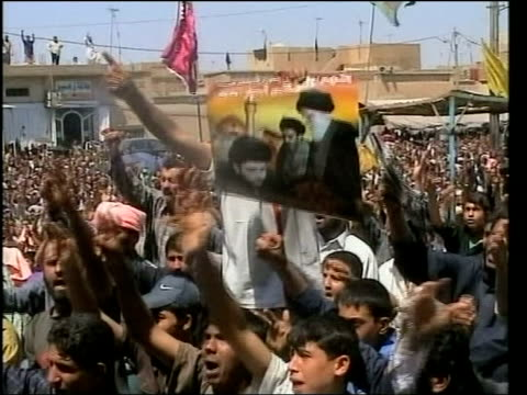 violence continues / more foreigners abducted / revolution threat itn ext crowd of shia muslims chanting in mass demonstration in support of alsadr... - muqtada al sadr stock videos & royalty-free footage