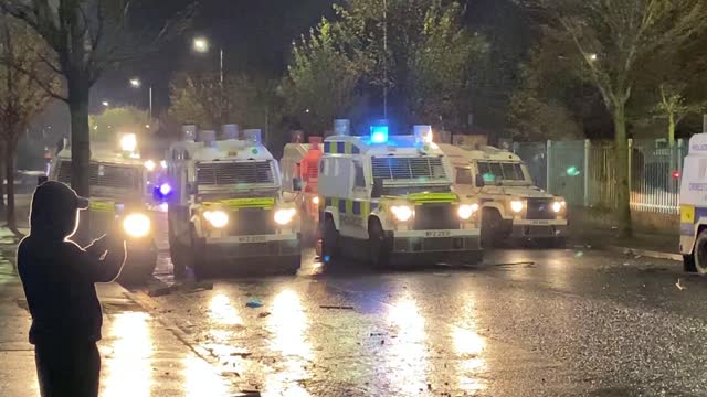 gvs police and protesters in belfast; northern ireland: belfast: ext / night general views of water cannon being used to disperse rioters /... - war and conflict stock-videos und b-roll-filmmaterial