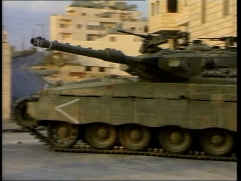 violence in bethlehem itn bv palestinian gunmen with rifles running in street ms convoy of israeli tanks along ms tank with turret runing ms tanks... - 2001 stock videos & royalty-free footage
