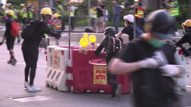 violent clashes between police and protesters in hong kong - protestor stock videos & royalty-free footage