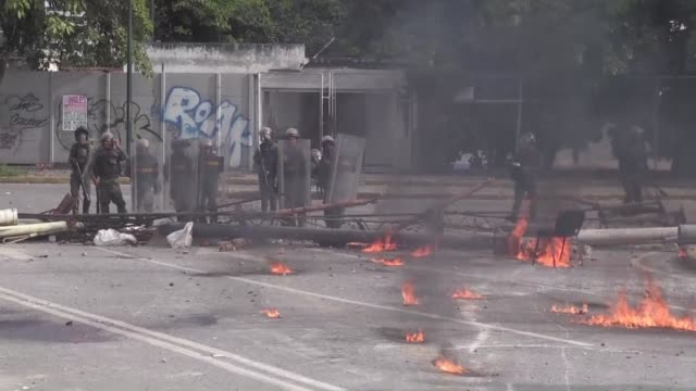 violent clashes broke out on thursday in venezuela between protesters and national guard leading to the deaths of two young men who were killed in... - national guard stock videos and b-roll footage