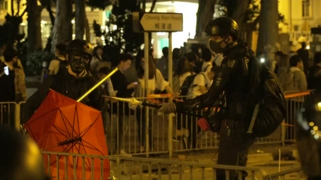 violent clashes on major university campuses continue; hong kong: ext / night various of protesters welding together metal barricades in street... - barricade stock videos & royalty-free footage