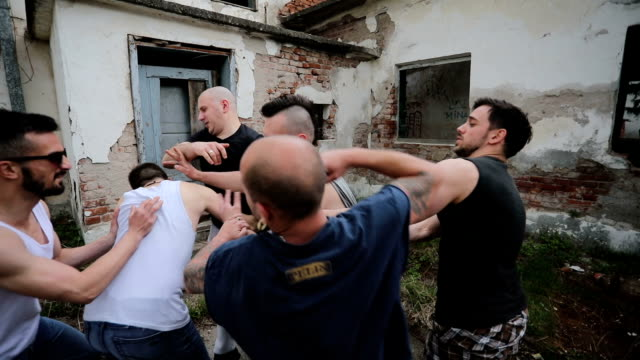 violent confrontation of opposite gangs - conflittualità video stock e b–roll
