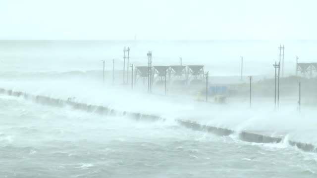 violent eye wall wind and rain lash hualien port during typhoon megi on 27th september 2016 - メギ点の映像素材/bロール