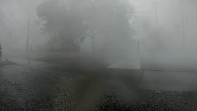 violent eyewall wind and rain from typhoon lingling lashes miyakojima in japan - major road stock-videos und b-roll-filmmaterial