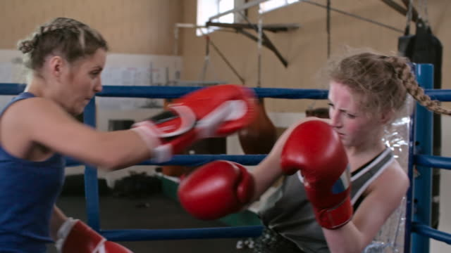 Violent female boxers fight