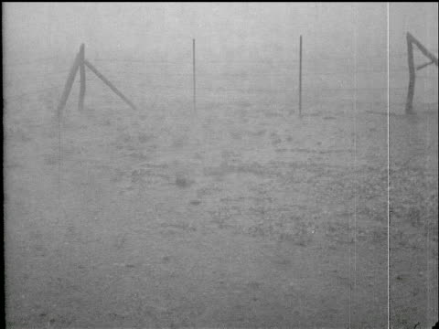 / violent hail storm huge stones on ground and in man's hands hail storm in saskatchewan on january 01 1934 in saskatchewan saskatchewan - saskatchewan stock videos and b-roll footage