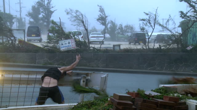 violent hurricane eyewall winds lash man - hurrikan stock-videos und b-roll-filmmaterial