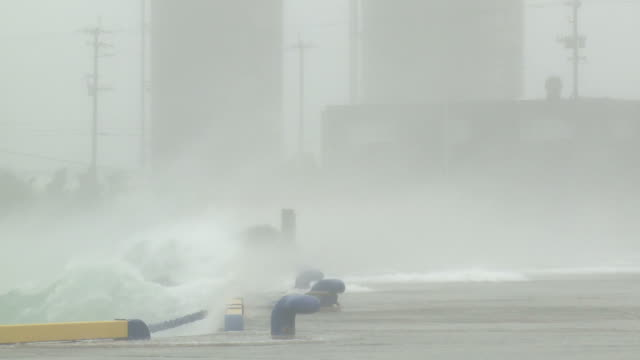 violent winds and storm surge in miyakojima port during typhoon songda / audio - typhoon stock videos and b-roll footage