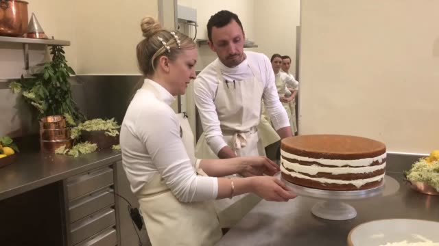 violet bakery's claire ptak talks through the royal wedding cake being served up for prince harry and meghan markle the layered lemon and elderflower... - prince harry stock videos and b-roll footage