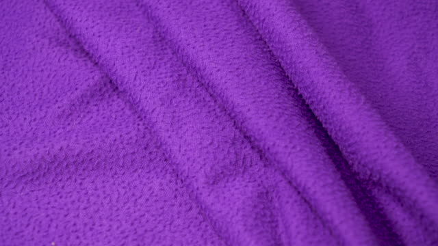 violet blanket texture background.pan shot uhd 4k - blanket texture stock videos and b-roll footage