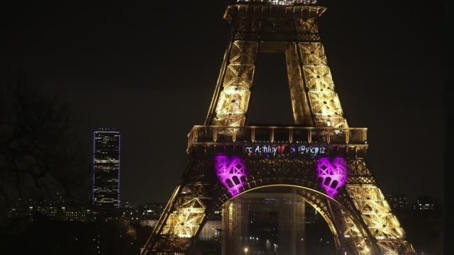 violet hearts are projected onto the eiffel tower to commemorate valentine's day on february 14, 2020 in paris, france. - eiffelturm stock-videos und b-roll-filmmaterial