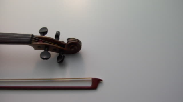 cu, pan, violin and bow on white background - strumento musicale video stock e b–roll