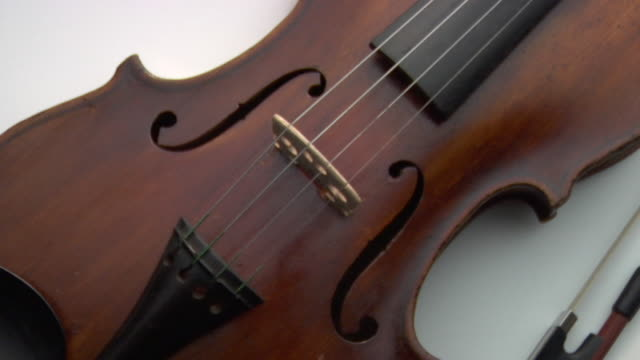CU, PAN, Violin and bow on white background