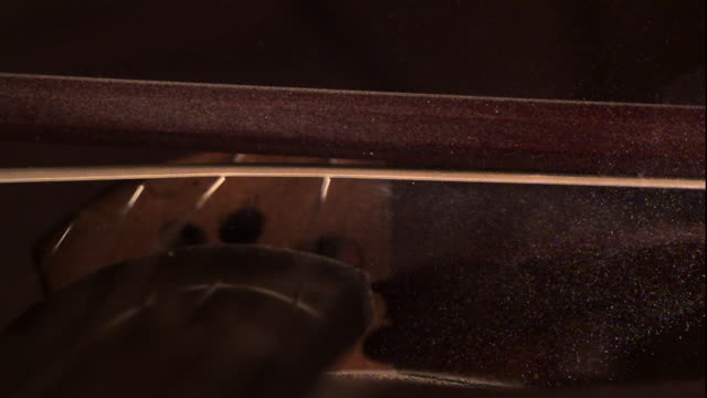 a violin bow is drawn across the strings of a violin - violin stock videos & royalty-free footage
