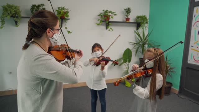 violin class during corona virus pandemic - musician stock videos & royalty-free footage
