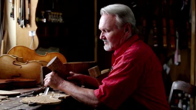 violin maker in his workshop - violin stock videos & royalty-free footage
