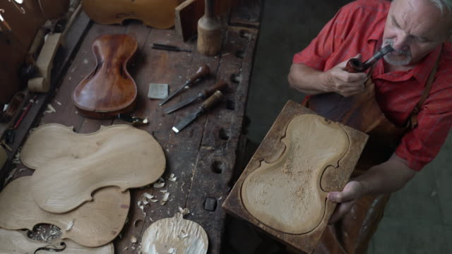 violin maker in his workshop - obsessive stock videos & royalty-free footage