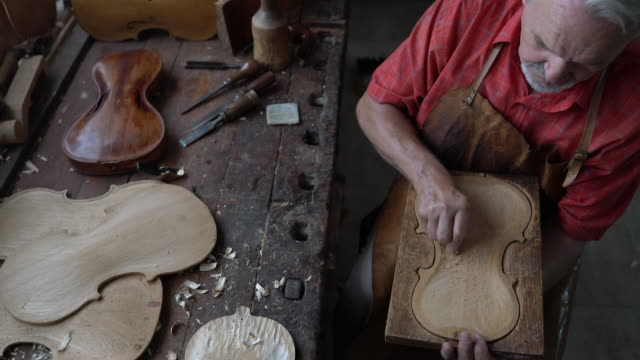 violin maker in his workshop - craftsperson stock videos and b-roll footage