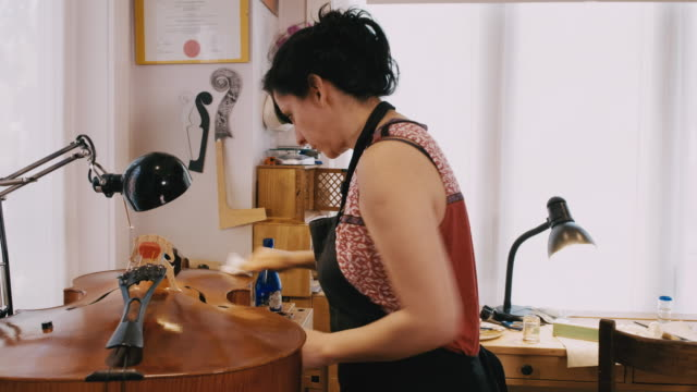 violin maker - one mature woman only stock videos & royalty-free footage