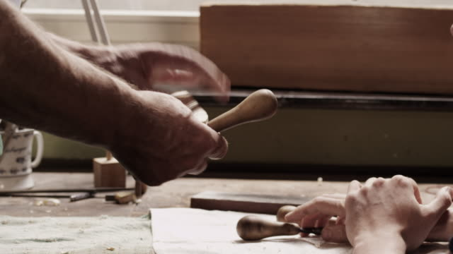 violin maker with apprentice - trainee stock videos & royalty-free footage