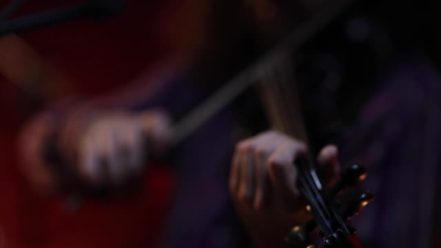 violinist playing electric violin on stage - rhythm stock videos & royalty-free footage