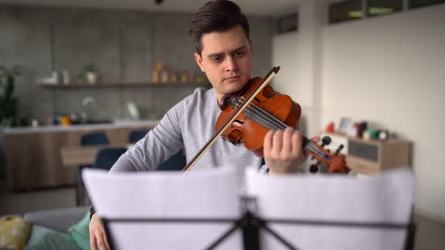 violinist rehearsing music piece in living room - sketch comedy stock videos & royalty-free footage
