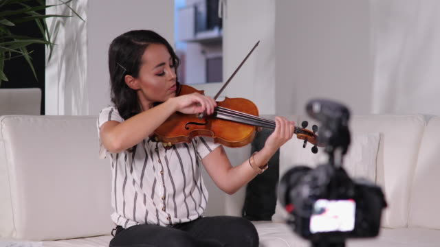 violinist teaching how to play violin online - violin stock videos & royalty-free footage