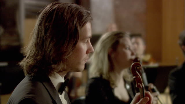 ms pan violinists performing in orchestra / london, united kingdom - 1 minute or greater stock videos & royalty-free footage