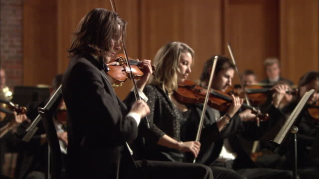 ms pan violinists performing in orchestra / london, united kingdom - orchestra stock videos & royalty-free footage