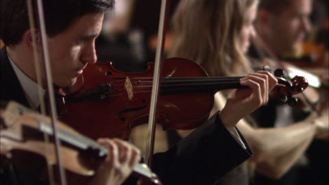 ms r/f violinists performing in orchestra / london, united kingdom - violin stock videos & royalty-free footage