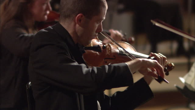 CU Violinists playing in orchestra / London, United Kingdom